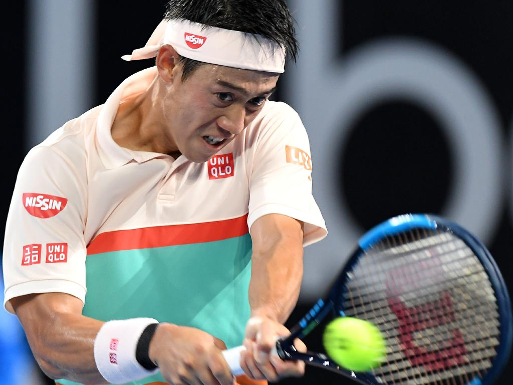 Kei Nishikori plays a backhand in the men's final.
