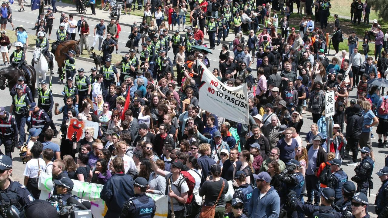 Left-wing and far-right wing protesters spill on to St Kilda Esplanade. Picture: AAP