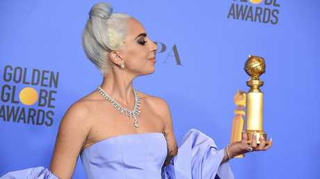 Lady Gaga poses in the press room with the award for best original song, motion picture for Shallow from the film A Star Is Born at the 76th annual Golden Globe Awards on Sunday, Jan. 6, 2019, in Beverly Hills, Calif.
