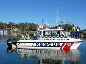 Fishermen rescued as boat flips crossing bar