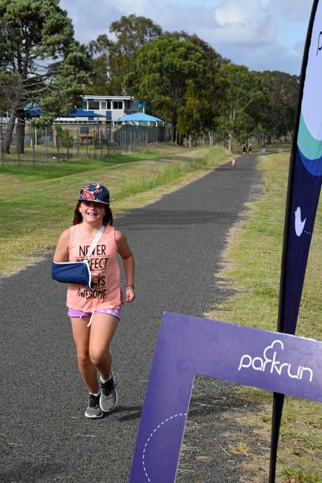 NO EXCUSES: Young runner, Olivia Fox does a personal best time despite having a broken arm.
