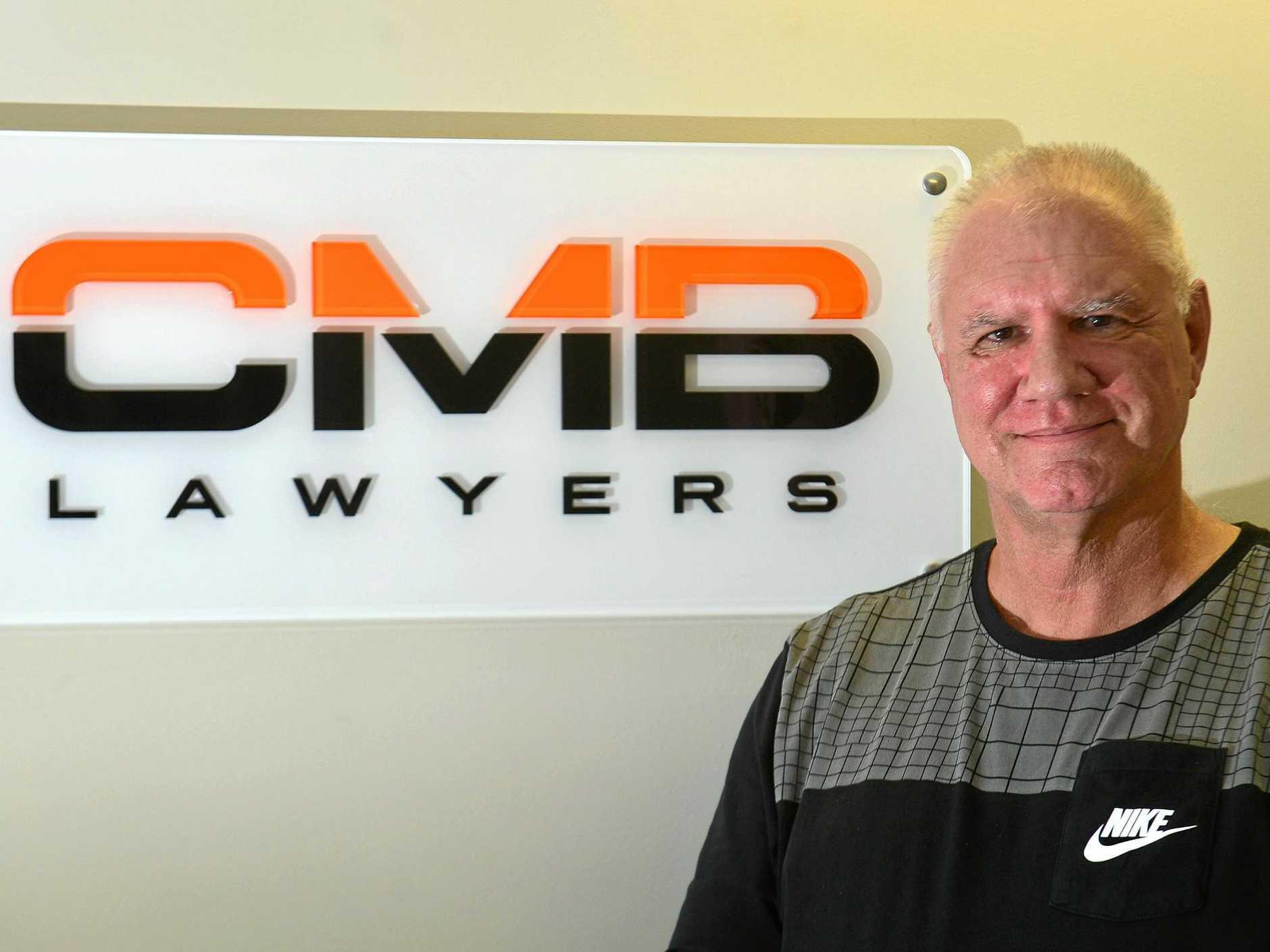 HELPING: Senior Associate at CMB Lawyers Glenn Wood.