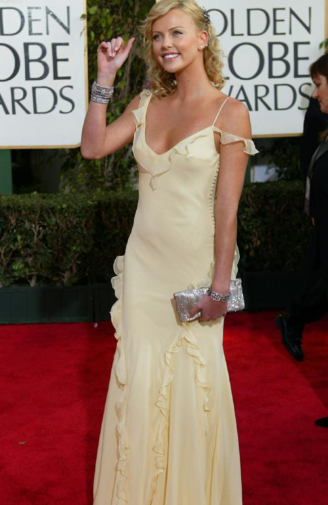 Charlize Theron was a golden goddess in this sorbet lemon coloured dress in 2004.