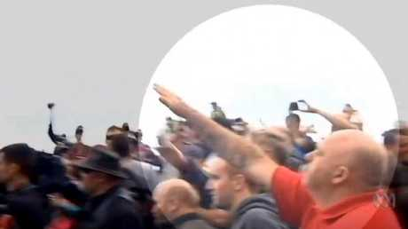 A far right extremist throws his arm up in a Nazi salute at St Kilda. Picture: ABC News