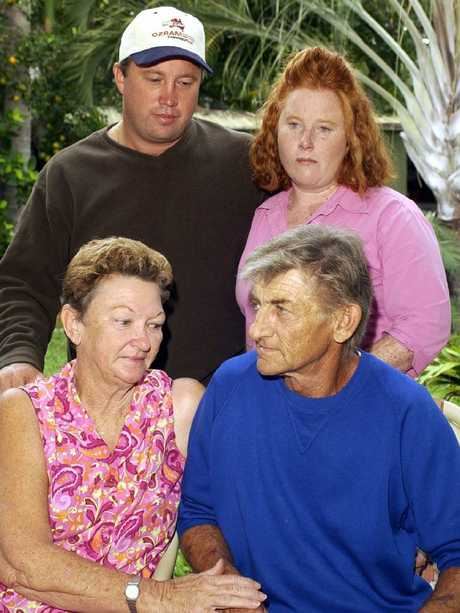 30 May 2003 Sassenach deckhand Ted Armfield, 61, (seated R) with his wife Adelyn and (children of missing boat skipper Ronald (Ron Ronny) David, 55, Peter David (top L) and his sister Shannan Castillo (top R) comfort each other after the sinking of the trawler. Pic Michael Chambers