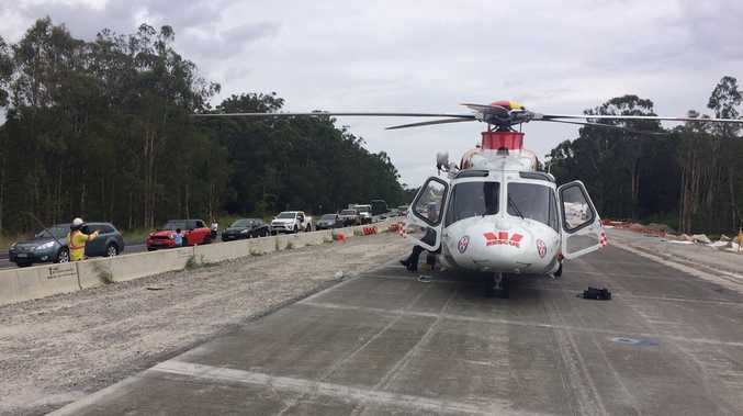 AIRLIFTED: The Westpac Life Saver Rescue Helicopter on the scene of a two-vehicle crash on the Pacific Highway at Mororo.