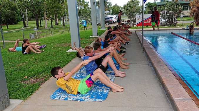 GETTING IN SHAPE: Members of the Cannonvale Cannons Swimming Club training hard out of the pool to start 2019.