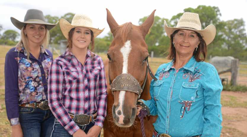 TOP ROPERS: Kylie Hancock, Tahnee Small and Julie Small with Julie's horse Jack after a successful Christmas Run.