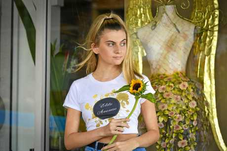 ALL FOR TOYAH: Local model Emily Gleeson participated in the shoots with sunflowers.