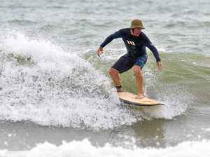 Surfers take on swell at North Wall, Mackay