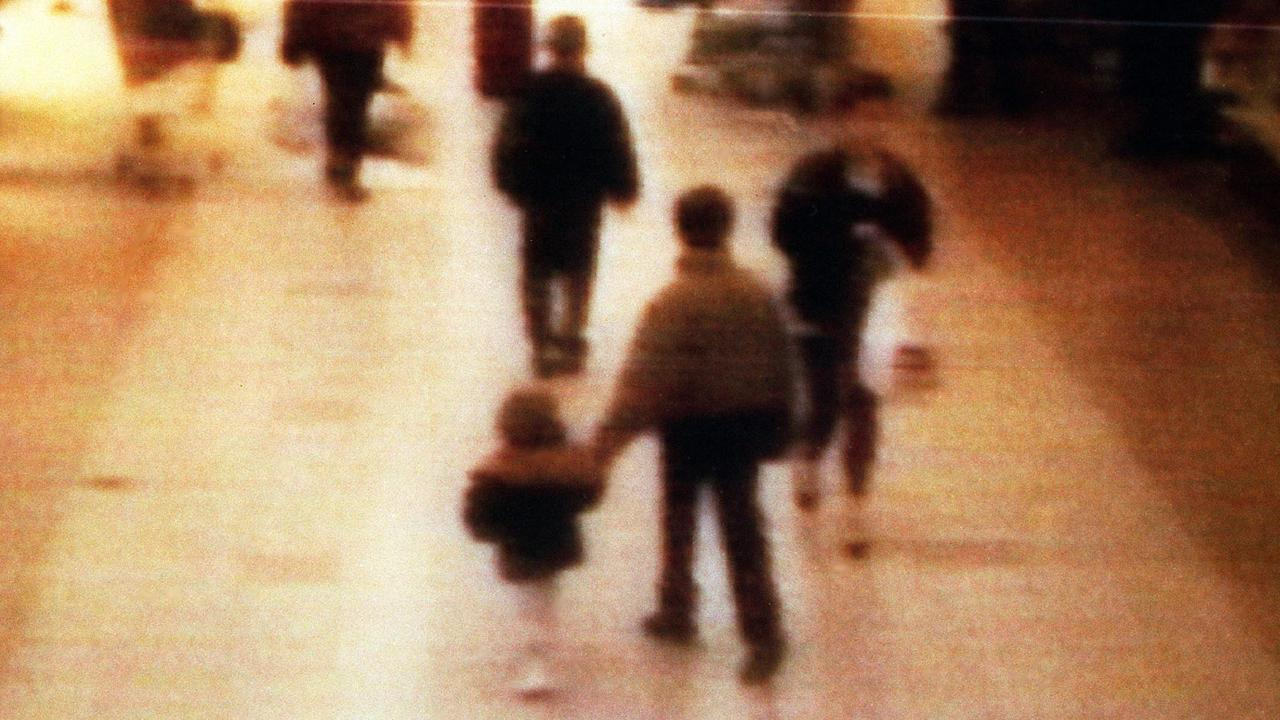 A surveillance camera shows James Bulger being led to his death by Jon Venables. Picture: BWP Media via Getty Images