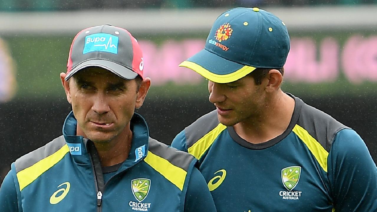 Australian captain Tim Paine (right) speaks with coach Justin Langer.