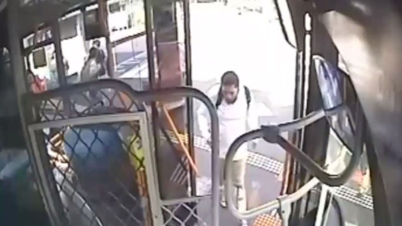 The man boarding the bus.