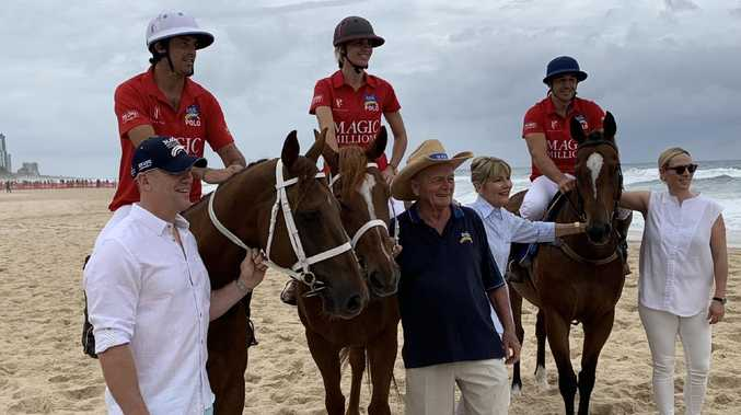 Celebrities including former NRL star Billy Slater gather on Surfers Paradise beach for the Magic Millions beach race.