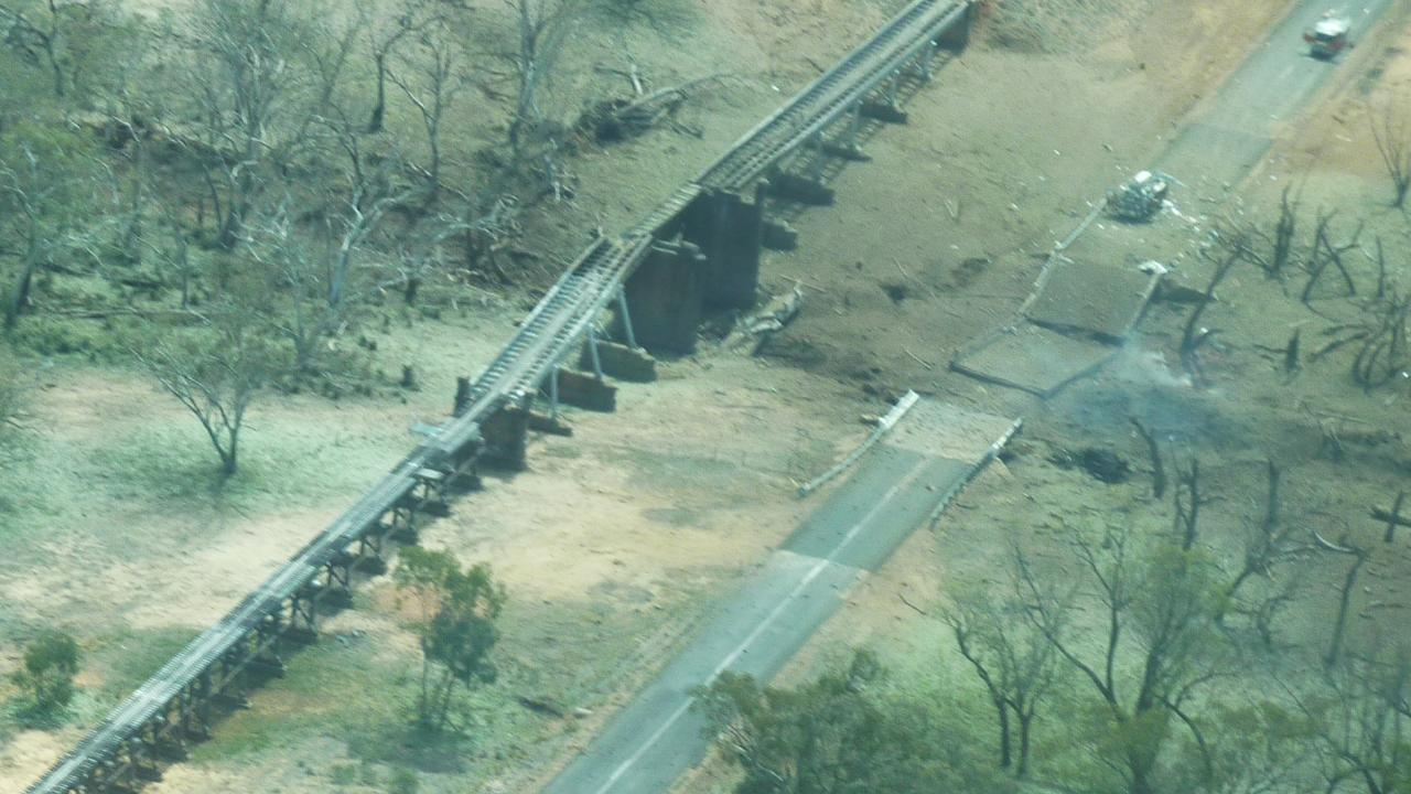 The damaged road and rail bridge. Picture: South West Air Service/Pete Wade