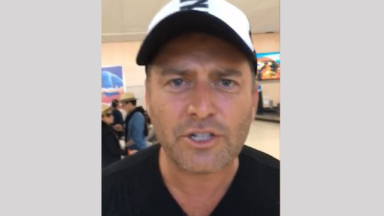 Karl Stefanovic lets loose on Christmas Day at Gold Coast's airport.