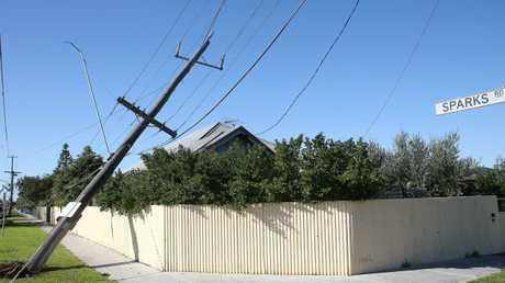 A compromised power pole belonging to Melbourne's Powercor after a car hit it. Powercor has not said how much of Melbourne's power is delivered underground. Picture: Peter Ristevski