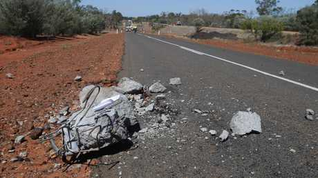 A 250kg block of concrete from the bridge lays 330m up the highway from the scene of the blast. Picture: Peter Wallis