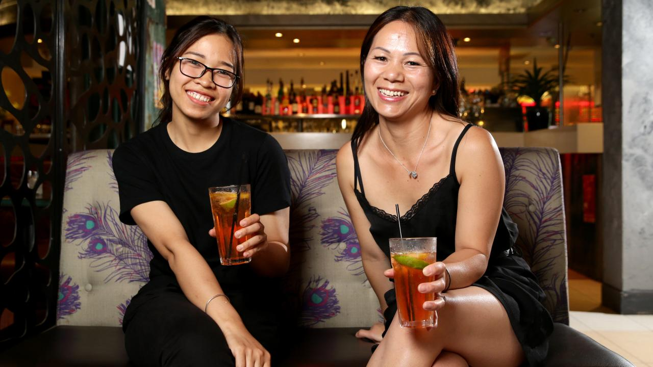Bell Pham and Von Huyn enjoying a lemon, lime and bitters. Ms Huyn considers it non-alcoholic. Picture: Jonathan Ng