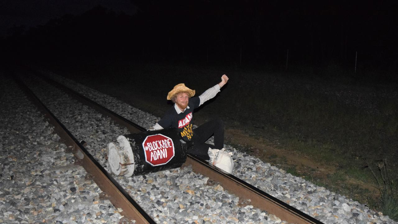 High schoolteacher Jesse Secomb, 37, blocked the Abbot Point Coal Terminal rail line to protest Adani's latest developments on its Carmichael Mine project.