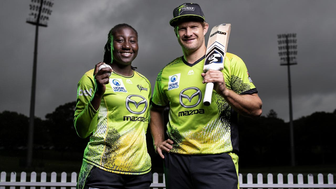 Shane Watson and Stefanie Taylor model the Sydney Thunder kits they will wear on Tuesday.