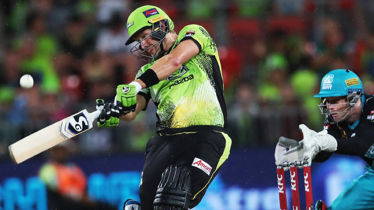 Sydney Thunder's Shane Watson smashes a six out of the ground on Tuesday night. Picture. Phil Hillyard