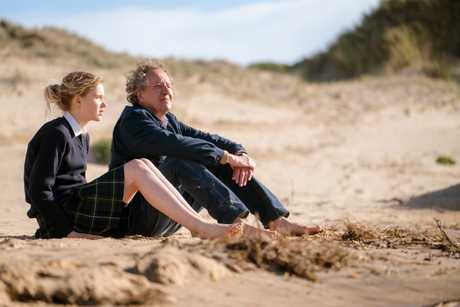 Morgana Davies and Geoffrey Rush in a scene from Storm Boy.