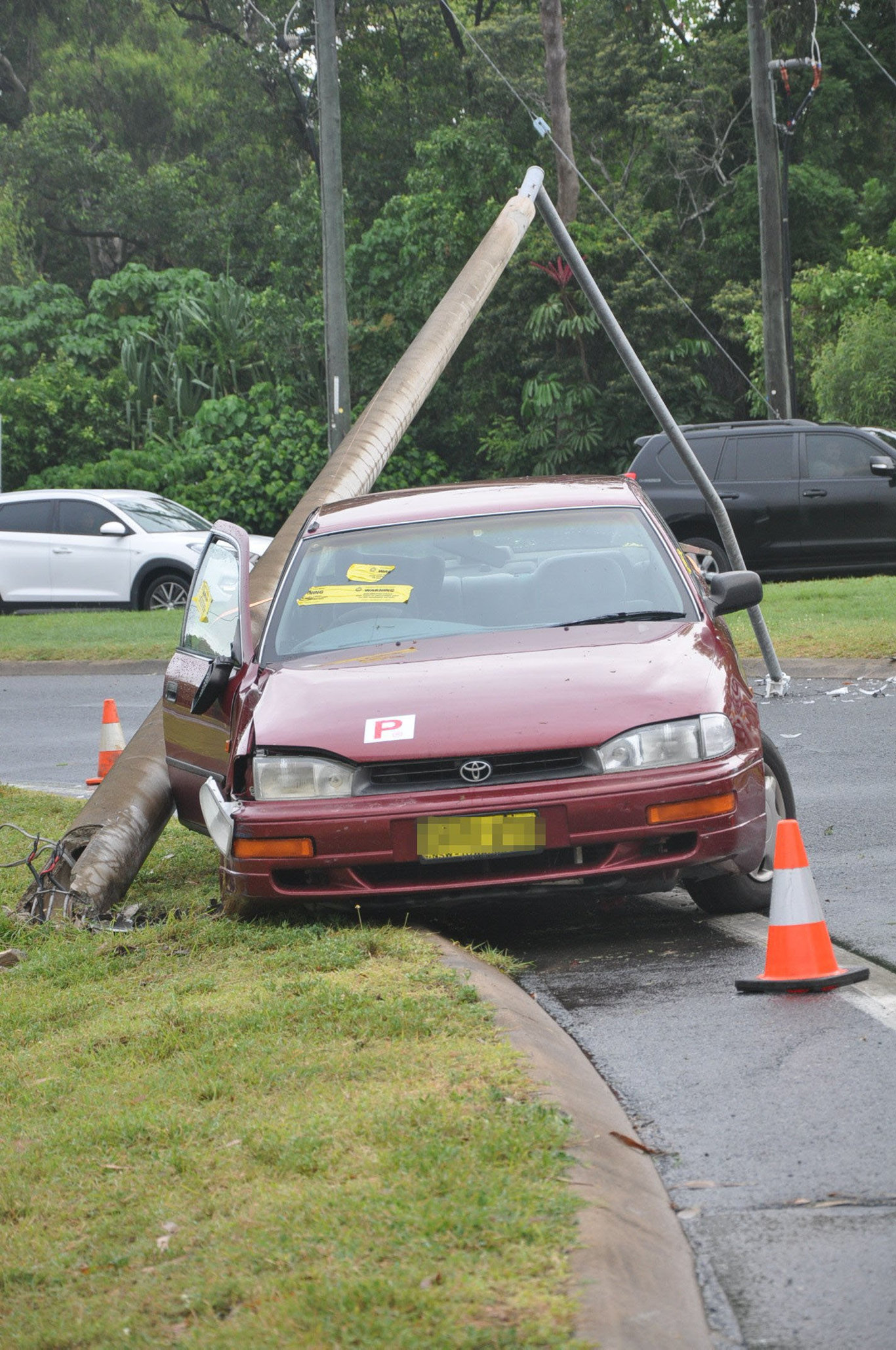 The female driver of the car that hit a power pole on Tanby Road roundabout in Yeppoon was taken to Yeppoon Hospital