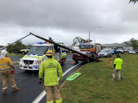 The ambulance damaged when a power pole fell as paramedics treated the driver of a car involved in a minor crash