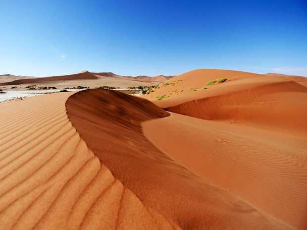 Where the red sand of the dunes is addictive.