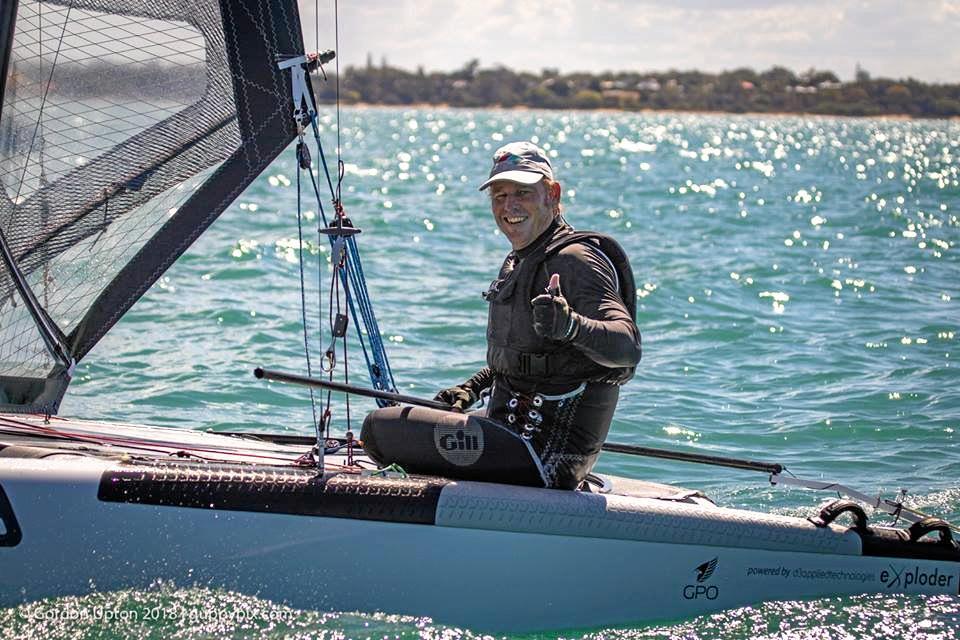 WORLD CHAMPION: Andrew Landenberger celebrates winning the A-Class Catamaran Classics title at Hervey Bay.