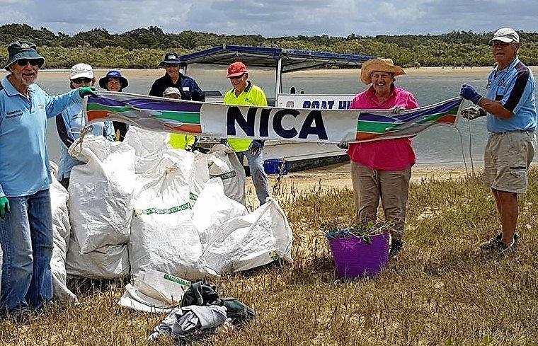 ISLAND SWEEP: NICA volunteers helping keep one of Noosa River's sand islands freed up for birdlife.