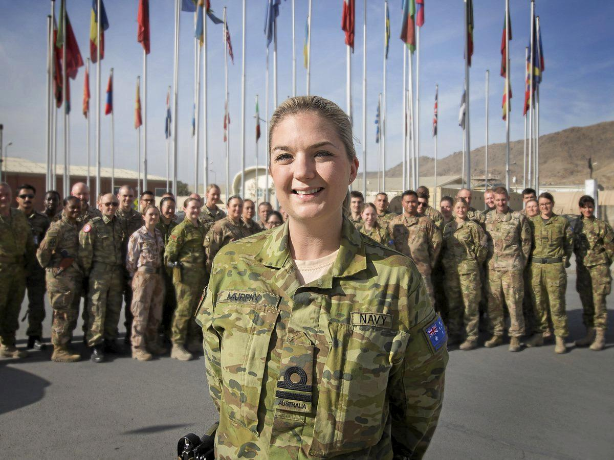 Royal Australian Navy doctor, Lieutenant Holly Murphy, RAN, in front of her coalition colleagues at Hamid Karzai International Airport in Kabul, Afghanistan.
