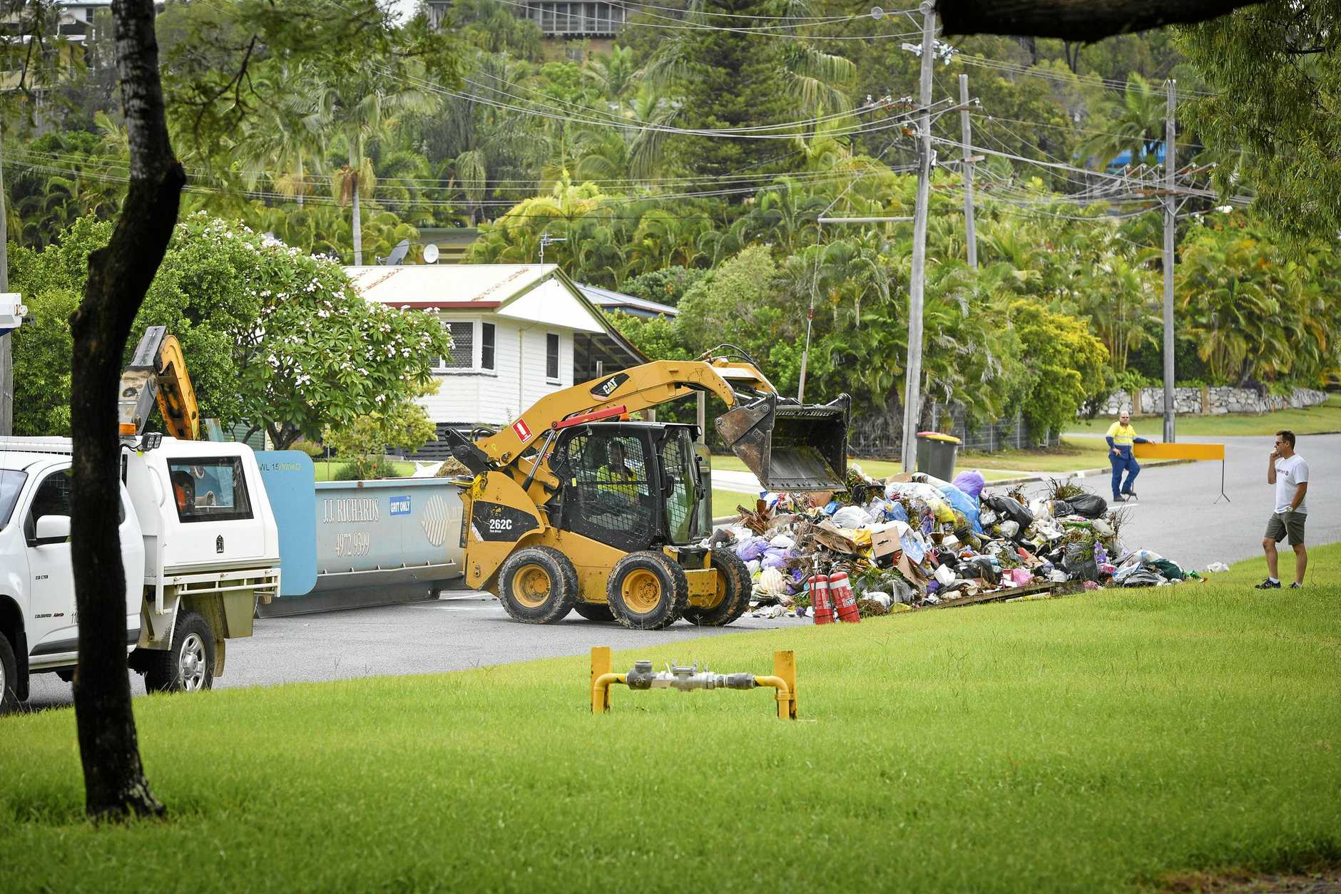 The clean up after another rubbish truck fire in Herbertson street, West Gladstone.