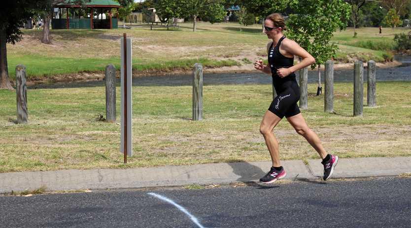 WINNING RUN: Jenny Costanzo crosses the finish line at the Australia Day Triathlon in 2018.