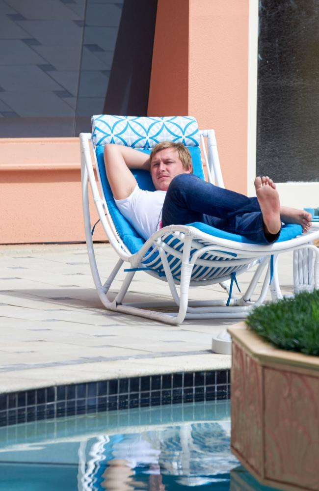 Former Gold Coast Bulletin reporter Jack Houghton reclines near the site which has been reportedly smashed.