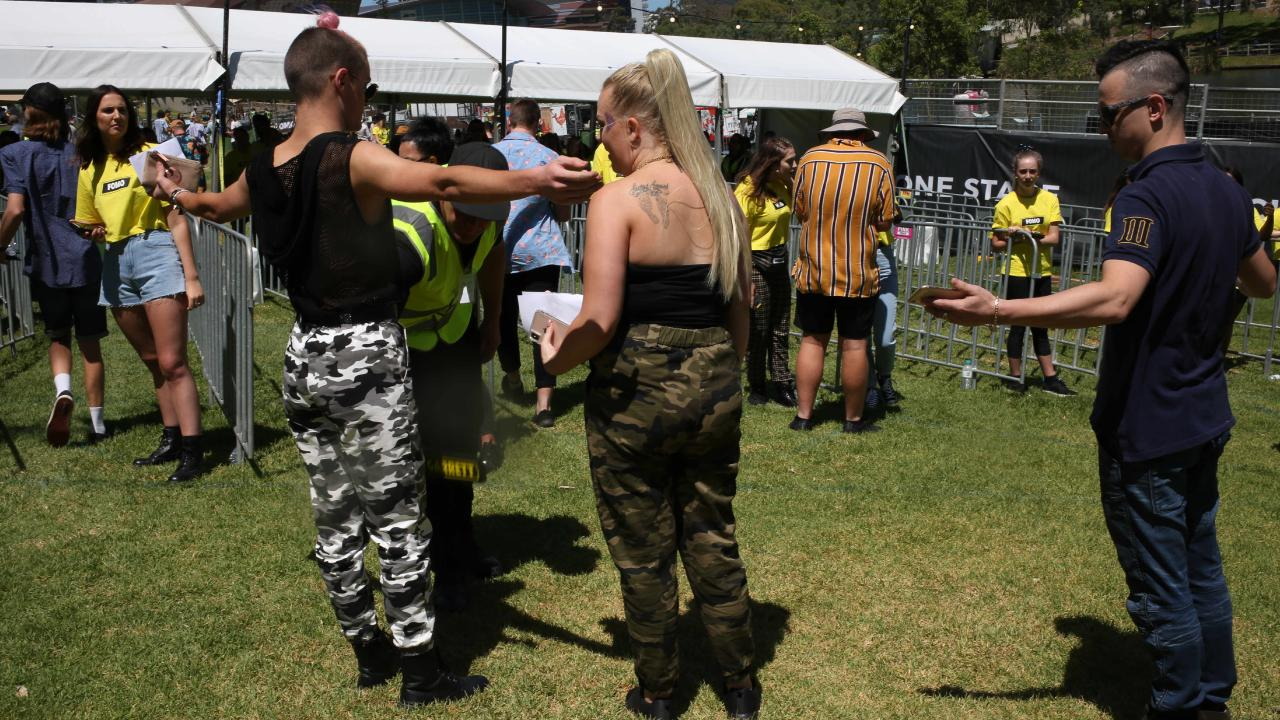 Police and security out in force with sniffer dogs checking concertgoers at the FOMO music festival Adelaide this week January. Picture: AAP/Emma Brasier