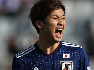 Japan snatch come-from-behind win