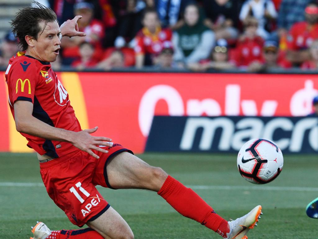 Craig Goodwin slides in to score for Adelaide United on Wednesday night. Picture: AAP