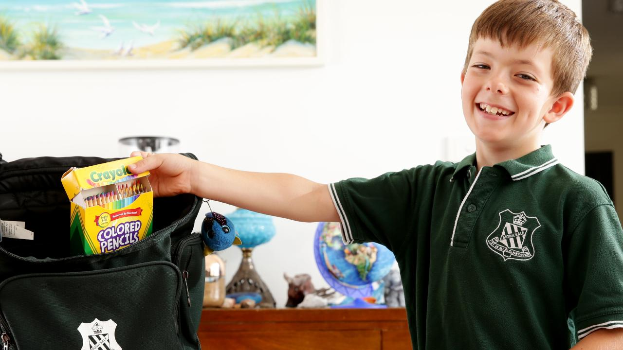 Flynn Weule, 9, gets his supplies ready for Year 4 at Mona Vale Public School. Picture: Jonathan Ng