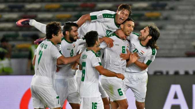 Iraq's defender Ali Adnan (2nd-R) celebrates. (Photo by Khaled DESOUKI / AFP)
