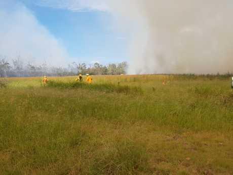 Fire crews fight a blaze at Burrum Heads on January 10.