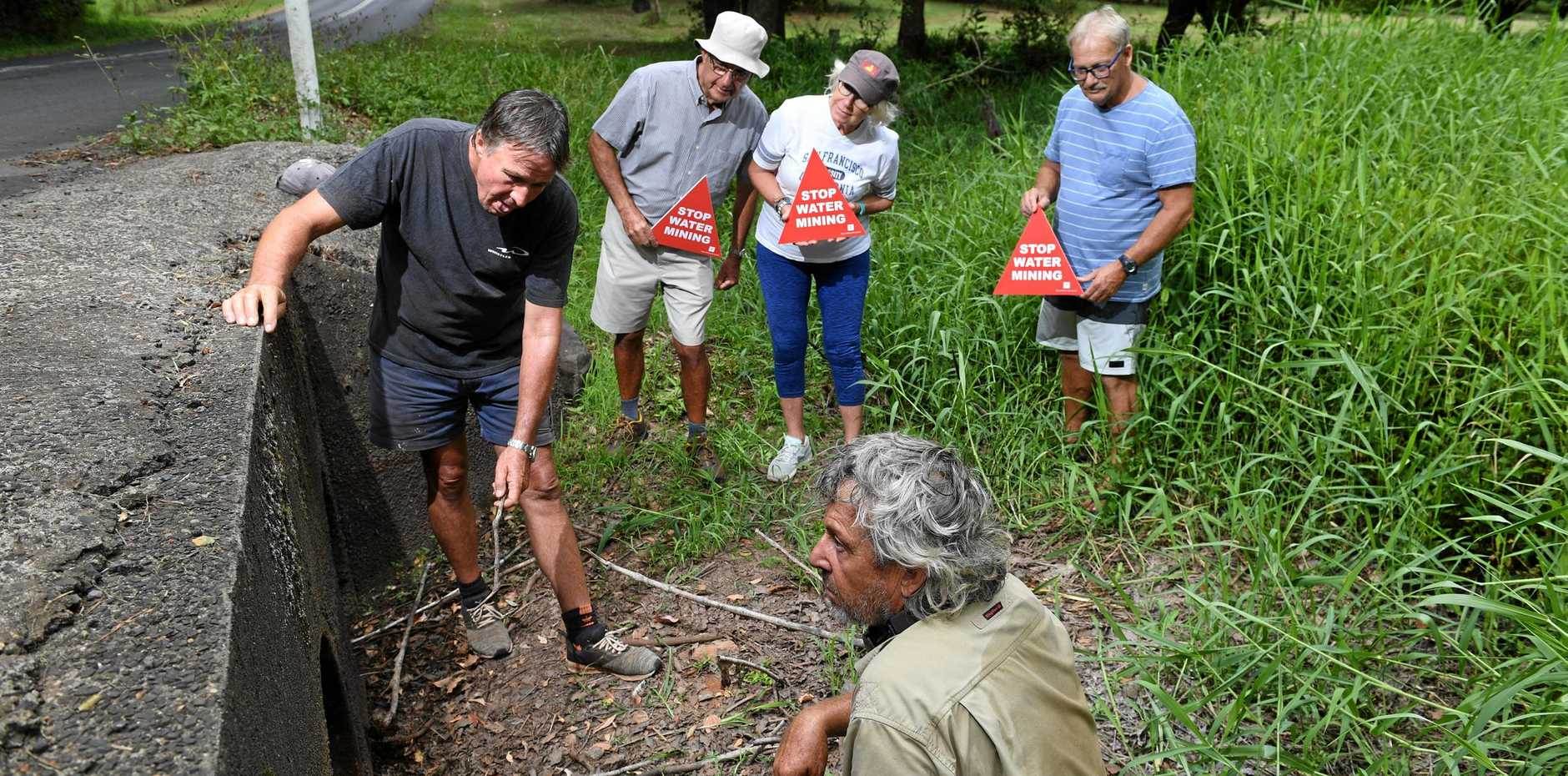 WATER WOES: Concerned residents Michael Hogan, Stephen Baker, David Huett, Lindsay Baker and Peter Ranford have raised issues with water mining on the Alstonville plateau.