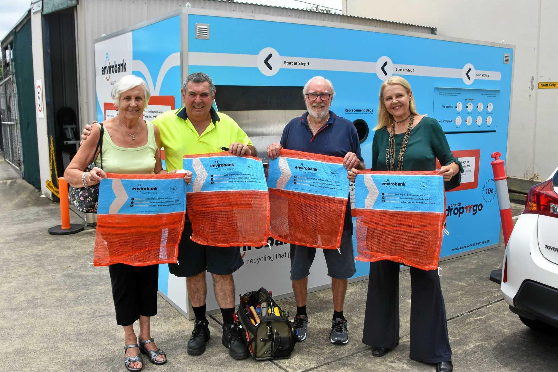 Teresa Stephenson, Vince D'Abarco, Bob Stephenson and Noosa MP Sandy Bolton with reusable Envirobank bags at Waves of Kindness, Noosaville.