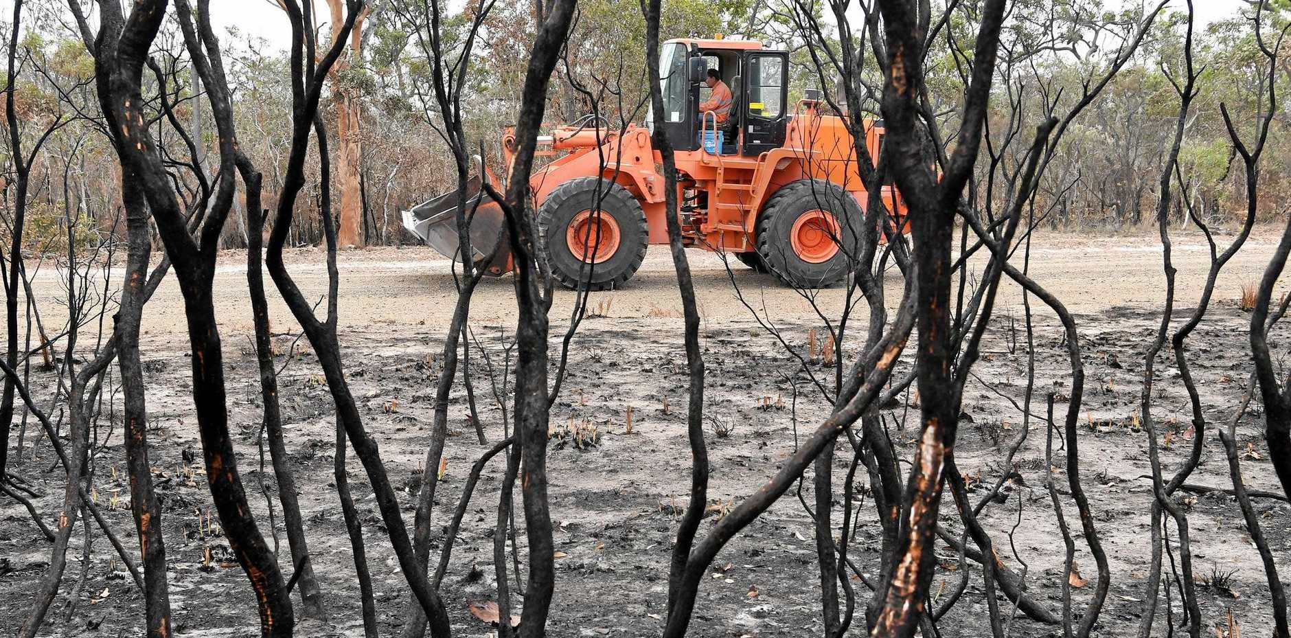 Earthmoving equipment in Deepwater after the fires swept through the region.