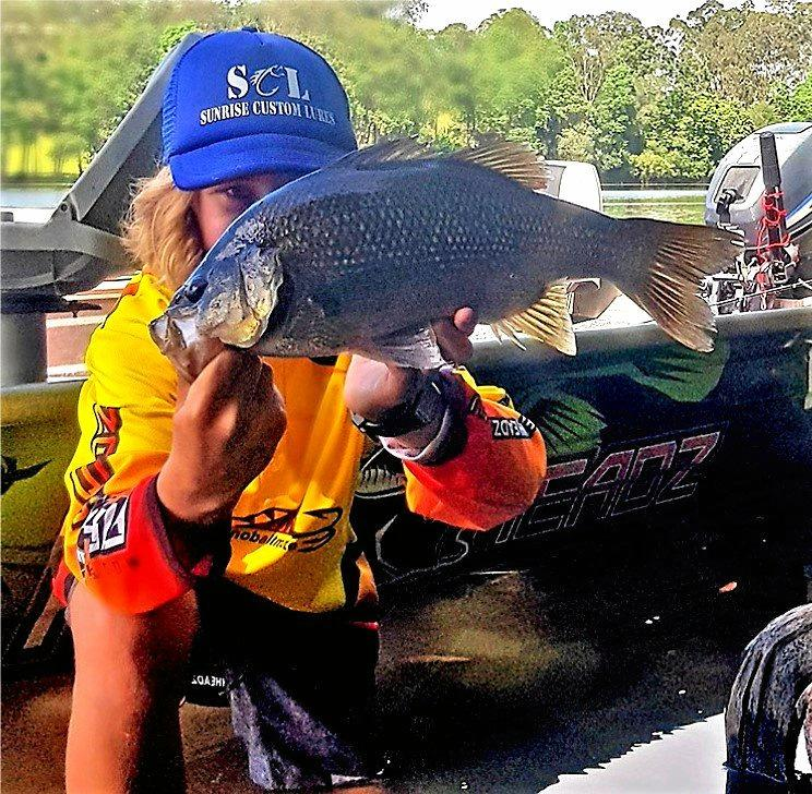 YOU BEAUT: Jed Hamblin caught and released four bass to 45cm in Noosa recently including this beauty.