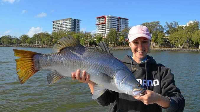 BIG CATCH: Jess van den Heuvel holds up a 1m-plus Barramundi, caught in the Fitzroy River.