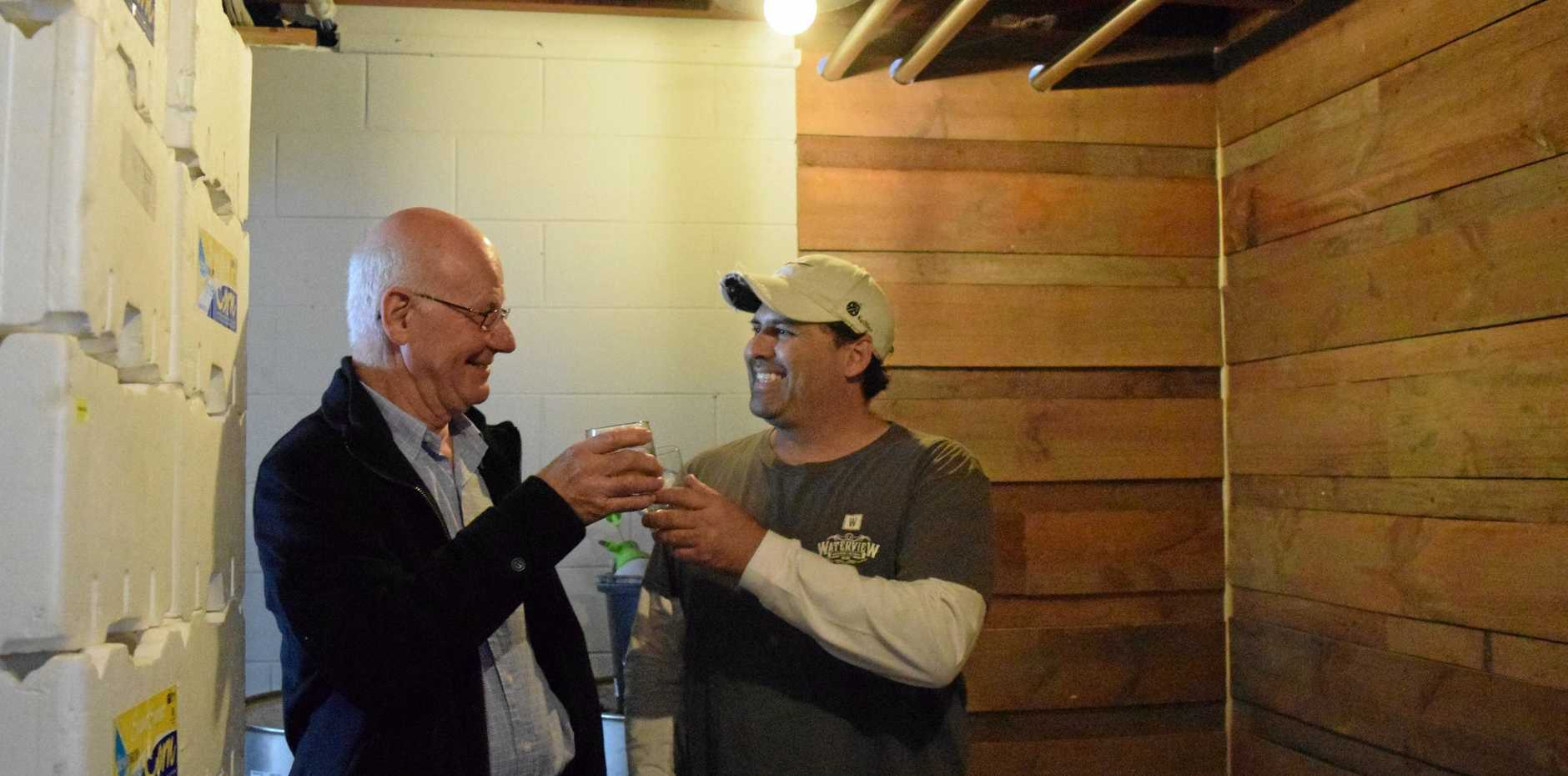 NICE DROP: Waterview Distillery's Matthew Drane having a taste of his brew with Dr Lou Muller.
