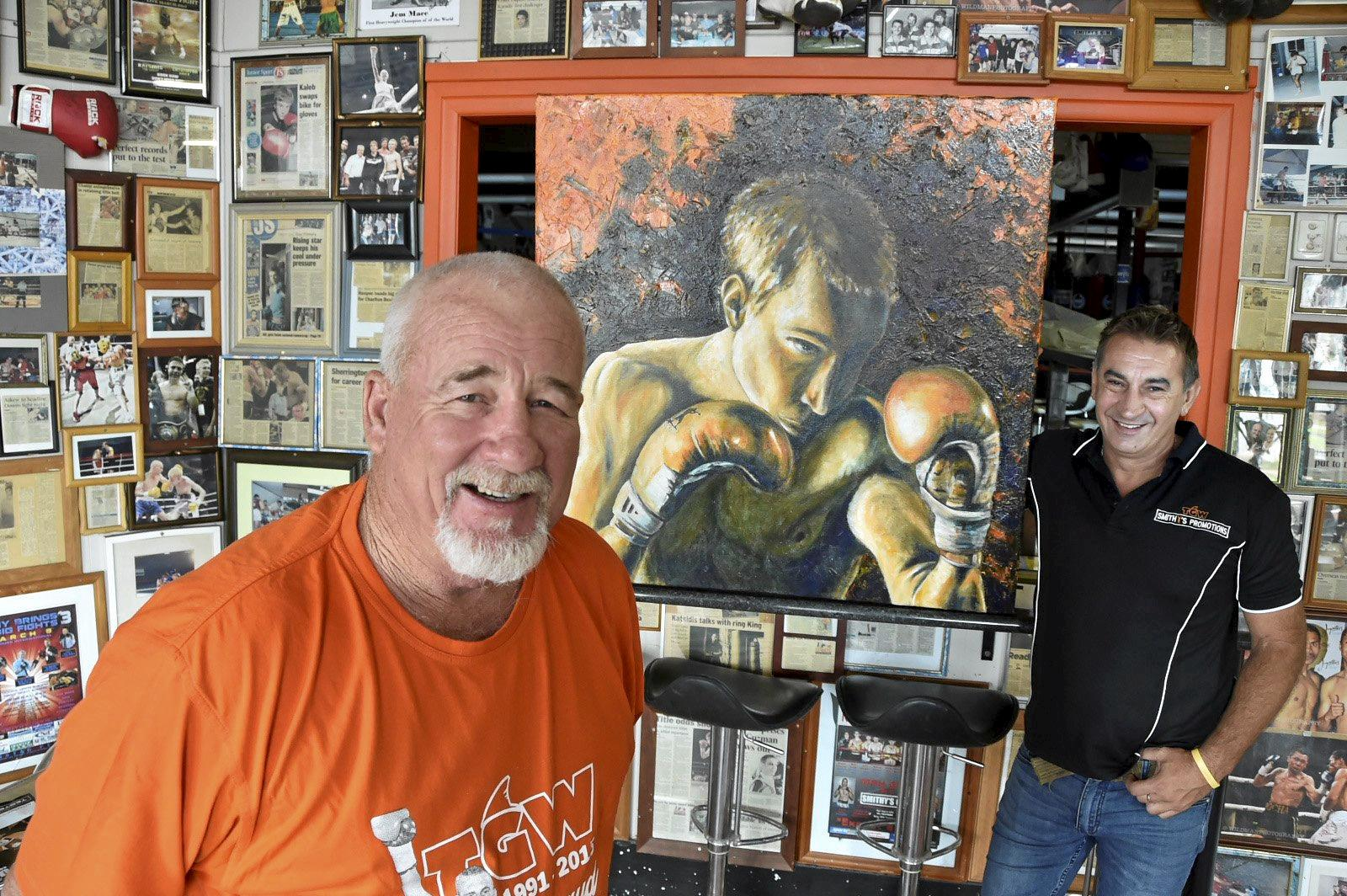 IN MEMORY: Rick Gay (left) and Brendan Smith admire the portrait of Braydon Smith, painted by Maryika Welter. The painting will be auctioned at a fight night in March.