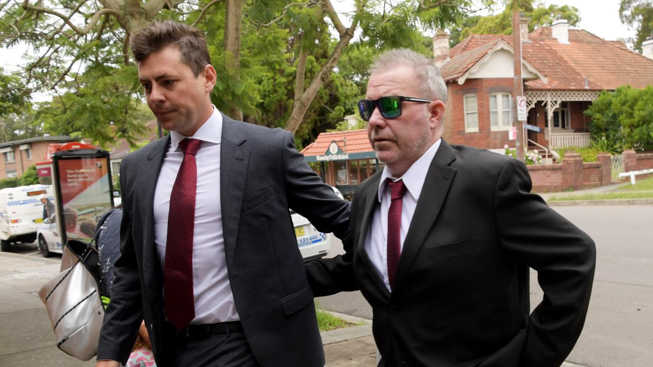1Bondi Rescue lifeguard Rod Kerr (L) arrives at Waverly Court for a mention and AVO application after being charged with making threats towards his ex-partner. Tracey Nearmy/Daily Telegraph